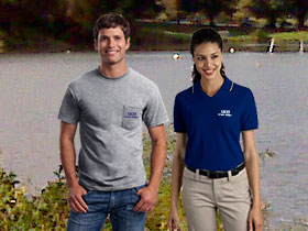 A man and woman wearing branded apparel at a public park